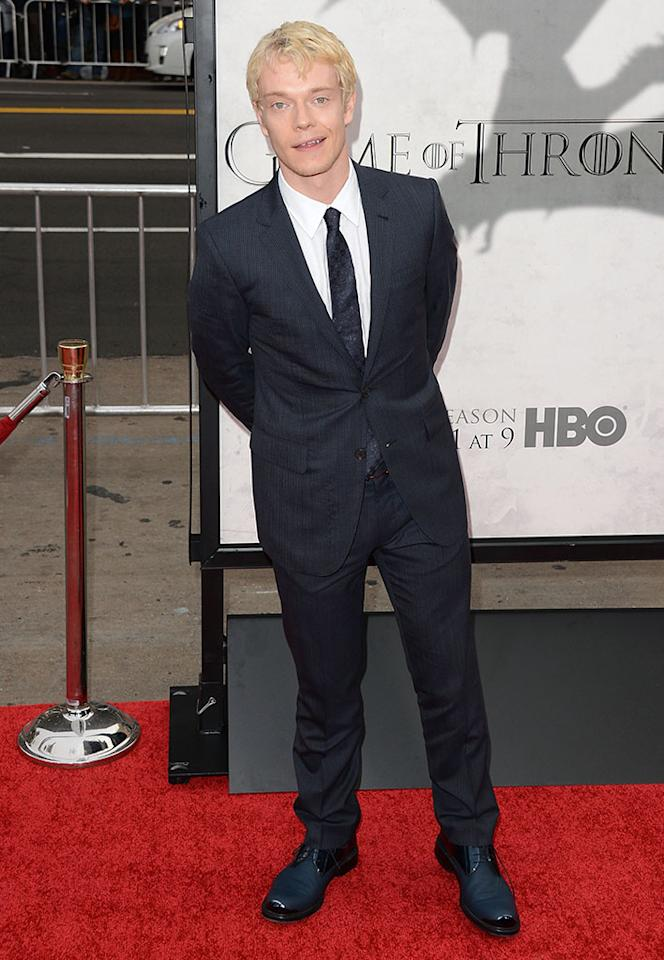 "Alfie Allen arrives at the premiere of HBO's ""Game of Thrones"" Season 3 at TCL Chinese Theatre on March 18, 2013 in Hollywood, California."