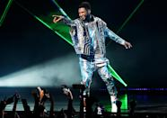 """<p>Usher points to the crowd at the grand opening of """"USHER The Las Vegas Residency"""" at the Colosseum at Caesars Palace in Las Vegas.</p>"""