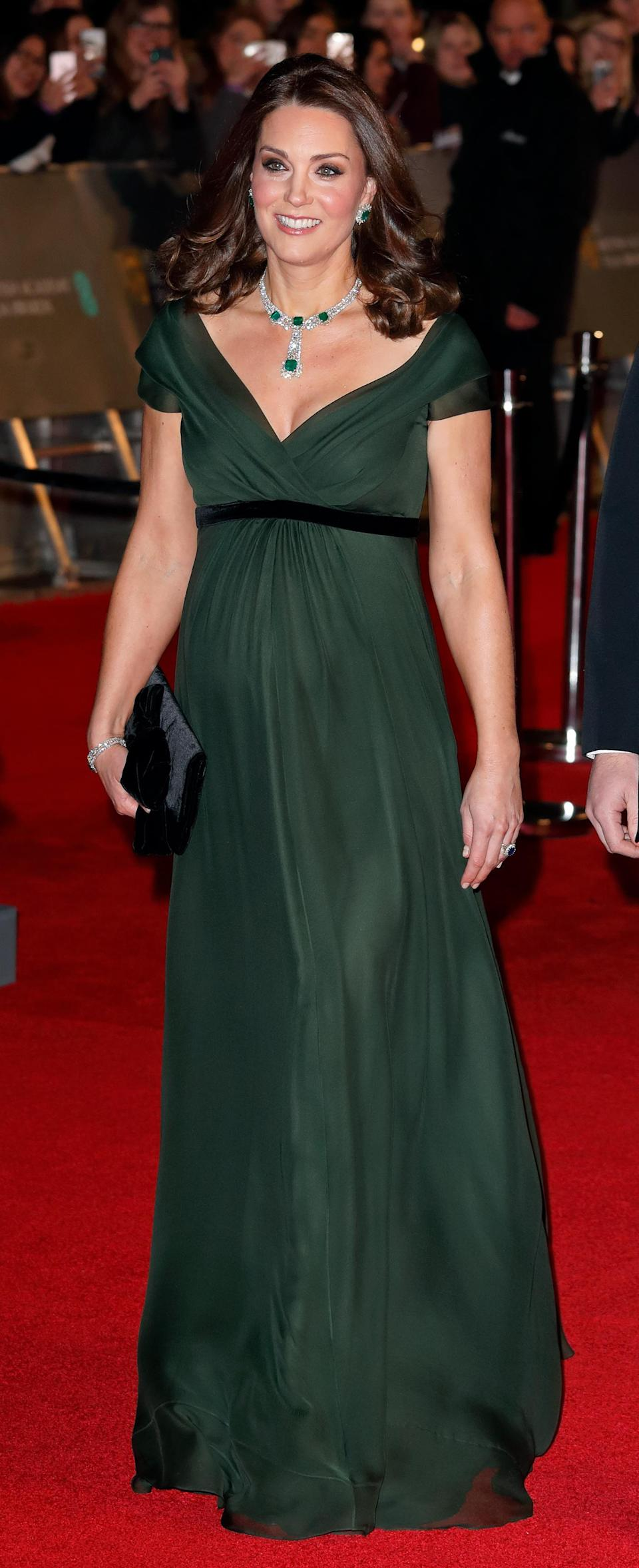 <p><strong>The occassion:</strong> The 2018 BAFTA Awards. <br><strong>The look: </strong>A dark green Jenny Peckham gown with a black belt, paired with a statement emerald necklace and earrings set and black velvet clutch. It was speculated as to whether the Duchess would honour the Time's Up movement by wearing black, but royal protocol forbids her from engaging with political statements. <br>[Photo: Getty] </p>