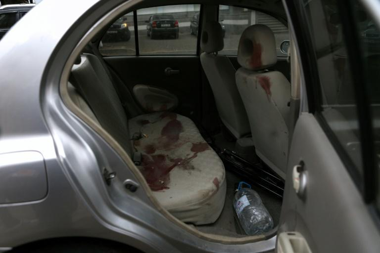 Journalists using this car were injured in shelling