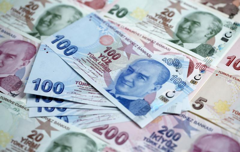 Turkish lira banknotes are seen in this photo illustration taken in Istanbul
