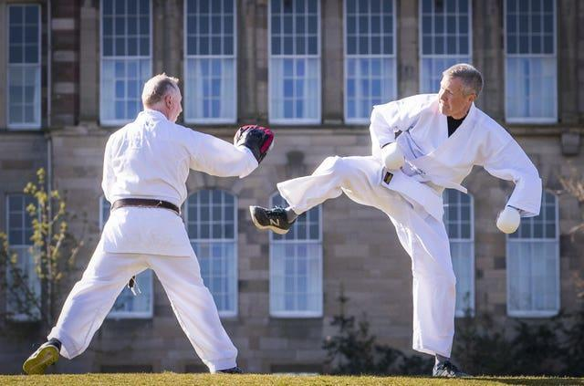 Willie Rennie (right) takes part in a karate lesson with Robert Steggles at The Meadows, Edinburgh, during campaigning