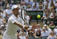Serbia's Novak Djokovic returns the ball to Belgium's David Goffin during a men's quarterfinal match on day nine of the Wimbledon Tennis Championships in London, Wednesday, July 10, 2019. (AP Photo/Tim Ireland)