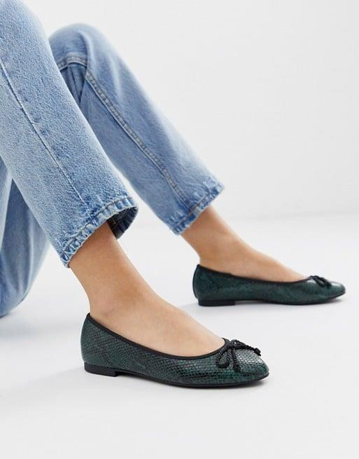 "<p>The color of these <a href=""https://www.popsugar.com/buy/ASOS-Design-Loretta-Bow-Ballet-Flats-485165?p_name=ASOS%20Design%20Loretta%20Bow%20Ballet%20Flats&retailer=us.asos.com&pid=485165&price=19&evar1=fab%3Aus&evar9=46556164&evar98=https%3A%2F%2Fwww.popsugar.com%2Ffashion%2Fphoto-gallery%2F46556164%2Fimage%2F46556580%2FASOS-Design-Loretta-Bow-Ballet-Flats&list1=shopping%2Cfall%20fashion%2Cshoes%2Cfall%2Cworkwear%2Cunder%20%2450%2Caffordable%20shopping&prop13=mobile&pdata=1"" rel=""nofollow"" data-shoppable-link=""1"" target=""_blank"" class=""ga-track"" data-ga-category=""Related"" data-ga-label=""https://us.asos.com/asos-design/asos-design-loretta-bow-ballet-flats-in-green-snake/prd/12481802?clr=green-snake&amp;colourWayId=16423701&amp;SearchQuery=&amp;cid=4172"" data-ga-action=""In-Line Links"">ASOS Design Loretta Bow Ballet Flats</a> ($19) is so pretty.</p>"