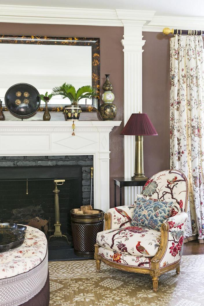 """<p>In the living room of <a href=""""https://www.veranda.com/decorating-ideas/house-tours/a33487567/markham-roberts-new-england-colonial-house-tour/"""" rel=""""nofollow noopener"""" target=""""_blank"""" data-ylk=""""slk:this Connecticut home"""" class=""""link rapid-noclick-resp"""">this Connecticut home</a> designed by Markham Roberts, chocolate brown walls are a foil for a host of antiques, including a French bergère from the Art Deco period that mingles with a 19th-century Indian shield, Chinese famille noire vase (1780), and an English peat bucket (1850). Chair upholstery, Cowtan & Tout. Antiques, <a href=""""https://www.jamessansum.com/"""" rel=""""nofollow noopener"""" target=""""_blank"""" data-ylk=""""slk:James Sansum Fine and Decorative Art"""" class=""""link rapid-noclick-resp"""">James Sansum Fine and Decorative Art</a></p><p><a class=""""link rapid-noclick-resp"""" href=""""https://www.ppgpaints.com/color/color-families/beiges/chocolate-truffle#:~:text=Chocolate%20Truffle%20is%20a%20deep,lighter%20tans%20for%20contrast%20areas."""" rel=""""nofollow noopener"""" target=""""_blank"""" data-ylk=""""slk:Get the Look"""">Get the Look</a></p>"""