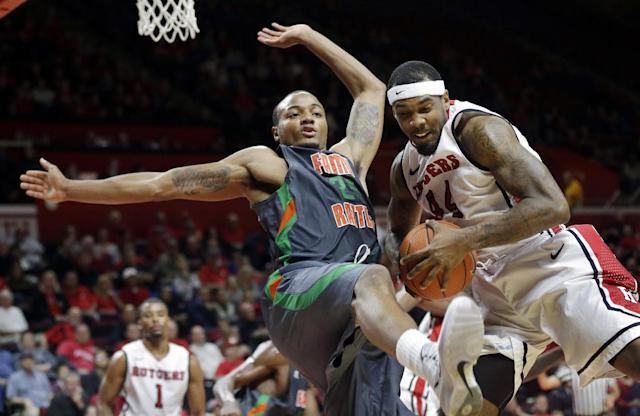Rutgers forward J.J. Moore, right, grabs the ball in front of Florida A&M forward Trey Kellum during the first half of an NCAA college basketball game in Piscataway, N.J., Friday, Nov. 8, 2013. (AP Photo/Mel Evans)