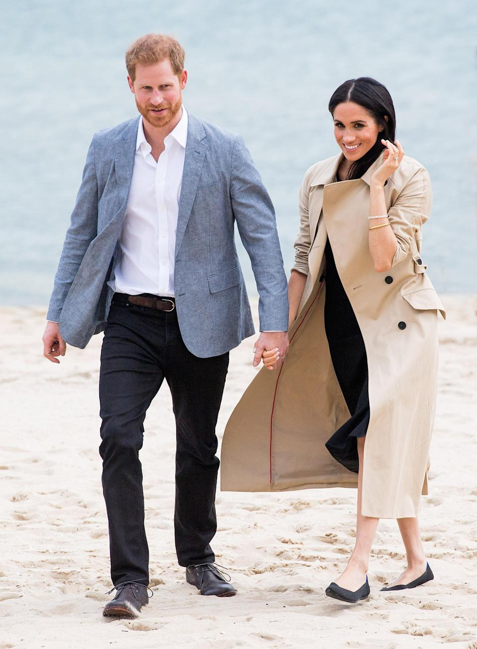 Meghan Markle and Prince Harry chose to keep their shoes on during a visit to South Melbourne beach yesterday. Source: Getty