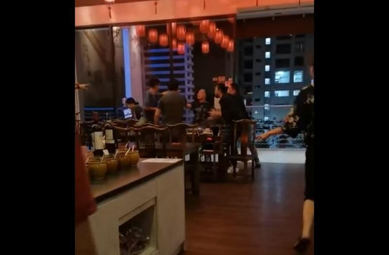 Police have arrested two men, one of whom claims to be a 'Datuk', after a video of them allegedly assaulting a young couple at a hotpot restaurant went viral on social media. — Screengrab via Facebook/Shinseki Mo