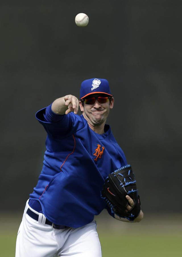 New York Mets pitcher Matt Harvey plays catch during spring training baseball practice Saturday, Feb. 22, 2014, in Port St. Lucie, Fla. Harvey underwent Tommy John surgery on Oct. 22. (AP Photo/Jeff Roberson)