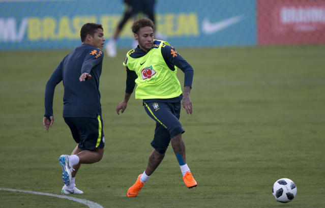 Brazil's Neymar, right, and Thiago Silva play around during a practice session of the Brazilian national soccer team ahead the World Cup in Russia, at the Granja Comary training center in Teresopolis, Brazil, Thursday, May 24, 2018. (AP Photo/Silvia Izquierdo)