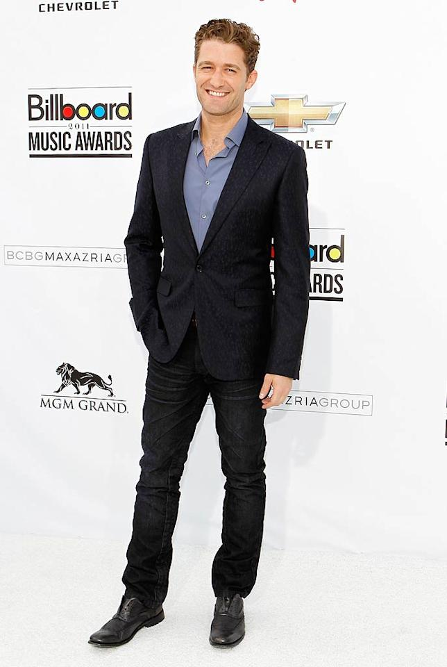 """""""Glee's"""" Matthew Morrison topped his dark denim with a conservative blue shirt and blazer combo that made him look more like a dad than an aspiring rock star. Isaac Brekken/<a href=""""http://www.gettyimages.com/"""" target=""""new"""">GettyImages.com</a> - May 22, 2011"""