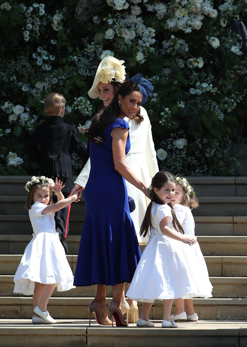 Jessica Mulroney and Kate Middleton entering the wedding ceremony. Both women received gold bracelets from Meghan Markle.
