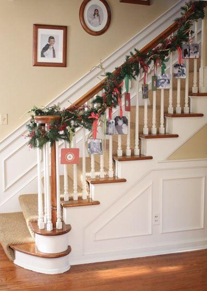 "<p>Display family photos and Christmas cards by hanging them on your banister's garland. </p><p>See more at <a href=""http://www.memoriesoncloverlane.com/2010/11/photo-garland.html"" rel=""nofollow noopener"" target=""_blank"" data-ylk=""slk:Clover Lane"" class=""link rapid-noclick-resp"">Clover Lane</a>. </p>"
