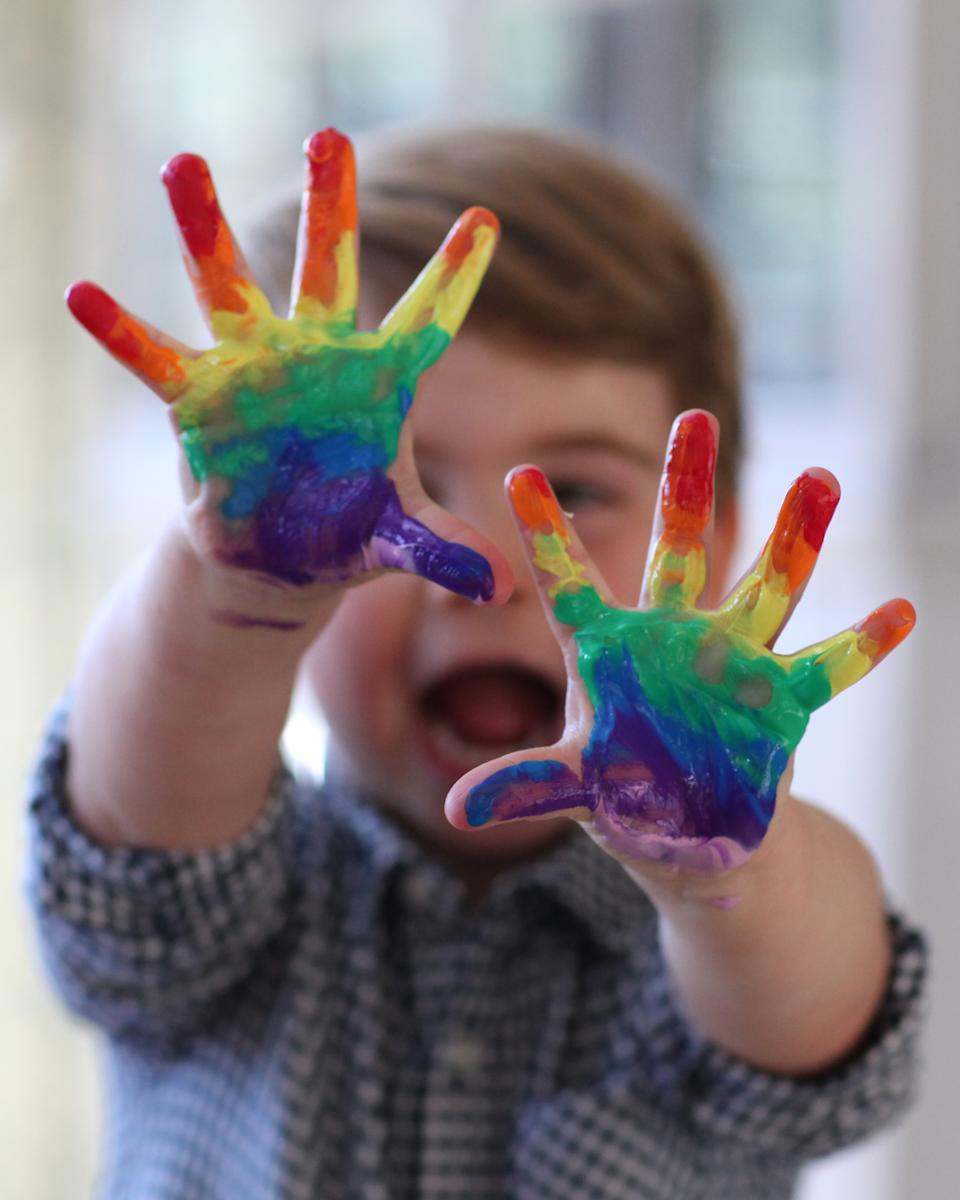 Louis shows off his coloured fingers. Duchess of Cambridge
