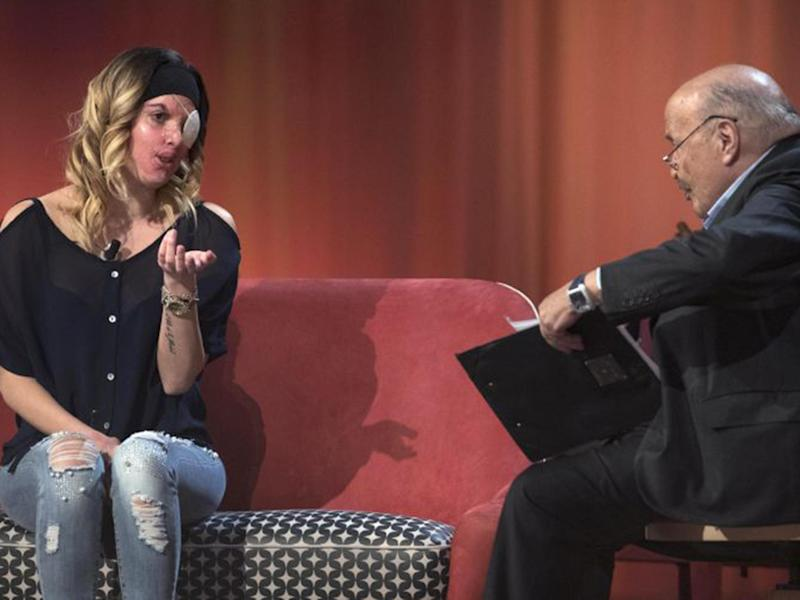Former Miss Italy finalist Gessica Notaro on the show with host Maurizio Costanzo: AP