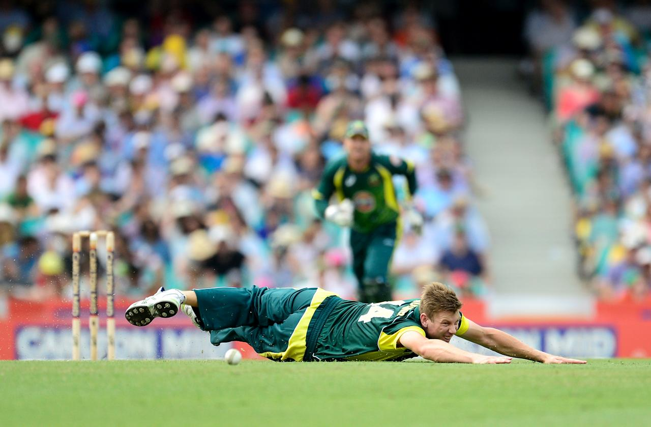 SYDNEY, AUSTRALIA - JANUARY 19: James Faulkner of Australia dives to field a ball during game three of the One Day International Series between Australia and England at Sydney Cricket Ground on January 19, 2014 in Sydney, Australia.  (Photo by Brett Hemmings/Getty Images)