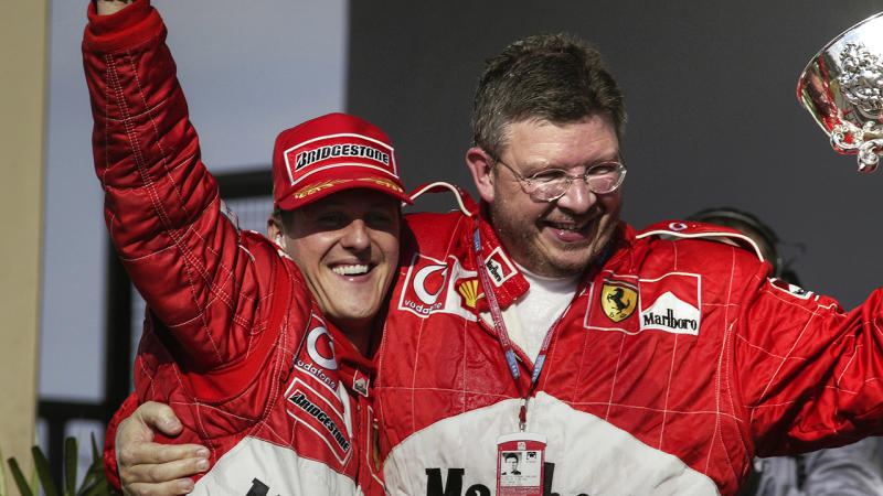 Michael Schumacher and Ross Brawn, pictured here at the Brazilian Grand Prix in 2002.