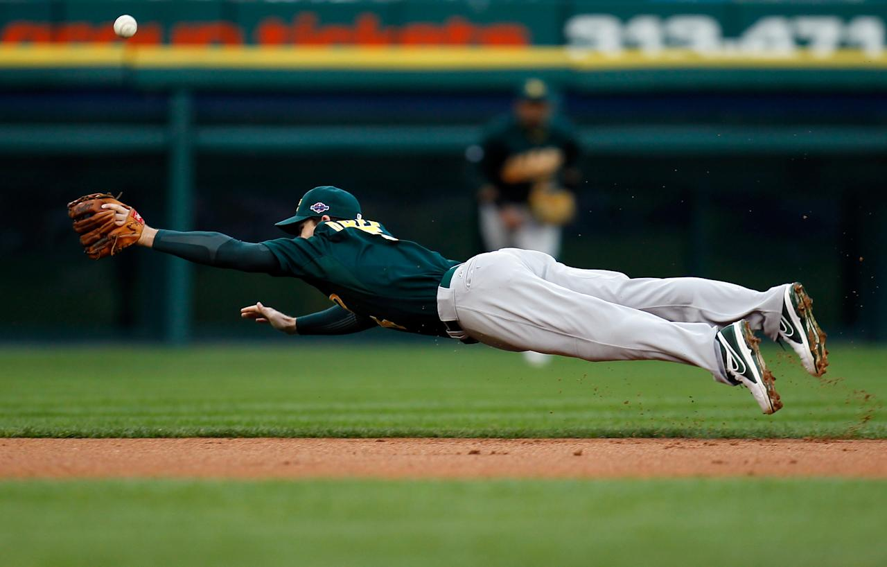 DETROIT, MI - OCTOBER 06:  Stephen Drew #5 of the Oakland Athletics can't make a play on a ball hit in the bottom of the first inning against the Detroit Tigers during Game One of the American League Divisional Series at Comerica Park on October 6, 2012 in Detroit, Michigan.  (Photo by Gregory Shamus/Getty Images)