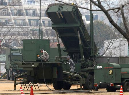 Japan Self-Defense Forces soldiers inject fuels into a unit of Patriot Advanced Capability-3 (PAC-3) missiles at the Defense Ministry in Tokyo