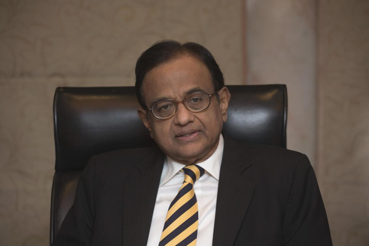 India's Finance Minister Chidambaram attends a news conference in Hong Kong