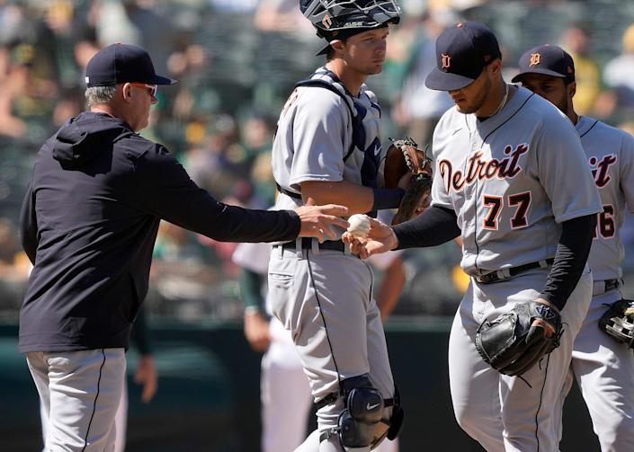 Tigers pitcher Joe Jimenez is taken out of a baseball game by manager AJ Hinch, left, during the seventh inning of the Tigers' 7-0 loss on Saturday, April 17, 2021, in Oakland, California.