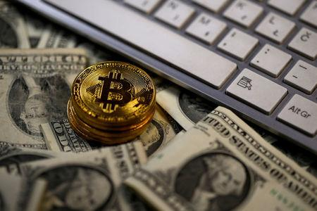 FILE PHOTO: Bitcoin (virtual currency) coins placed on Dollar banknotes are seen in this illustration picture