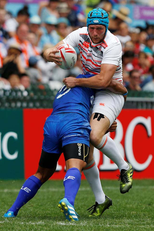 Rugby Union - England v Samoa - Hong Kong Sevens - Hong Kong Stadium, Hong Kong, China - 8/4/2017 - England's Richard de Carpentier (R) is tackled by Samoa's Alamanda Motuga.  REUTERS/Bobby Yip