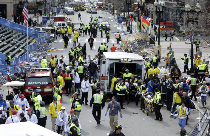 FILE - In this April 15, 2013 file photo, medical workers aid injured people at the finish line of the 2013 Boston Marathon following an explosion in Boston. A federal grand jury in Boston returned a 30-count indictment against bombing suspect Dzhokhar Tsarnaev on Thursday, June 27, 2013, on charges including using a weapon of mass destruction and bombing a place of public use, resulting in death. (AP Photo/Charles Krupa, File)