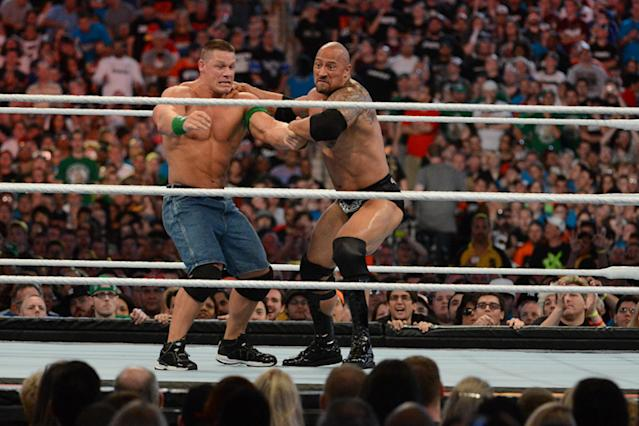 "Dwayne ""the Rock"" Johnson and John Cena in action during WrestleMania 28 at Sun Life Stadium on April 1, 2012, in Miami Gardens, Florida. (Photo by Ron Elkman/Sports Imagery/Getty Images)"