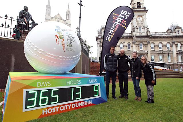 """DUNEDIN, NEW ZEALAND - FEBRUARY 14: Classic Hits staff pose for a photo during the """"One Year To Go"""" to the ICC Cricket World Cup announcement at the Octagon on February 14, 2014 in Dunedin, New Zealand. (Photo by Rob Jefferies/Getty Images)"""