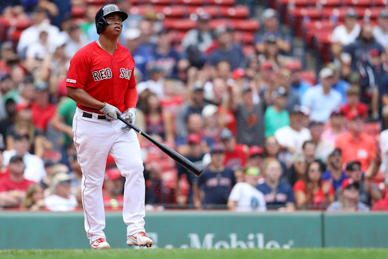 BOSTON, MASSACHUSETTS - AUGUST 18: Rafael Devers #11 of the Boston Red Sox watches his home run during the seventh inning against the Baltimore Orioles at Fenway Park on August 18, 2019 in Boston, Massachusetts. (Photo by Maddie Meyer/Getty Images)