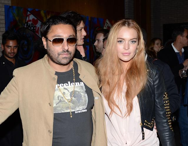 """NEW YORK, NY - MAY 10: Vikram Chatwal and Lindsay Lohan attend the Domingo Zapata """"Life Is A Dream"""" Art Exhibition at Dream Downtown on May 10, 2012 in New York City. (Photo by Andrew H. Walker/Getty Images)"""