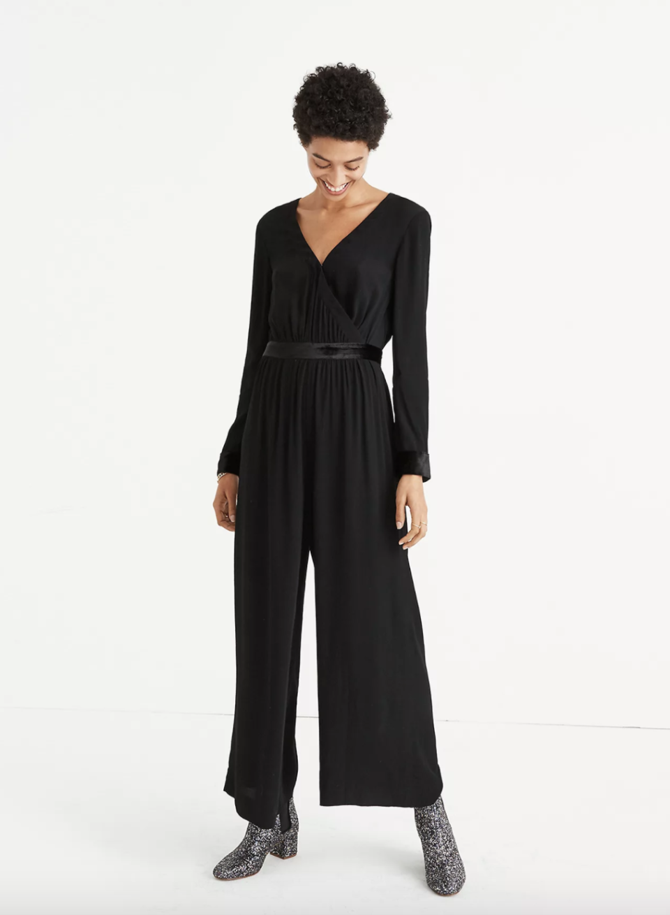"""<p><strong>Madewell</strong></p><p>madewell.com</p><p><strong>$64.99</strong></p><p><a href=""""https://go.redirectingat.com?id=74968X1596630&url=https%3A%2F%2Fwww.madewell.com%2Fvelvet-trimmed-tie-jumpsuit-H2098.html&sref=https%3A%2F%2Fwww.goodhousekeeping.com%2Fbeauty%2Ffashion%2Fg25400387%2Fnew-years-eve-outfits%2F"""" rel=""""nofollow noopener"""" target=""""_blank"""" data-ylk=""""slk:Shop Now"""" class=""""link rapid-noclick-resp"""">Shop Now</a></p><p>For a hint of velvet, go with this jumpsuit that's just trimmed with the festive material. </p>"""