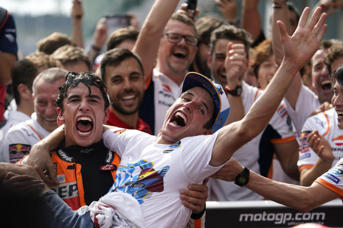 In this Sunday, Nov. 3, 2019, file photo, Spain's MotoGP rider Marc Marquez, left, celebrates with his brother Spain's Moto2 rider Alex Marquez after winning the second place of MotoGP race of the Malaysia Motorcycle Grand Prix at Sepang International circuit in Sepang. (AP Photo/Vincent Thian, File)