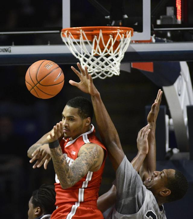 Ohio State's LaQuinton Ross loses control of a rebound as Penn State's Jordan Dickerson reaches in during the first half of an NCAA college basketball game on Thursday, Feb. 27, 2014, in State College, Pa. (AP Photo/Ralph Wilson)