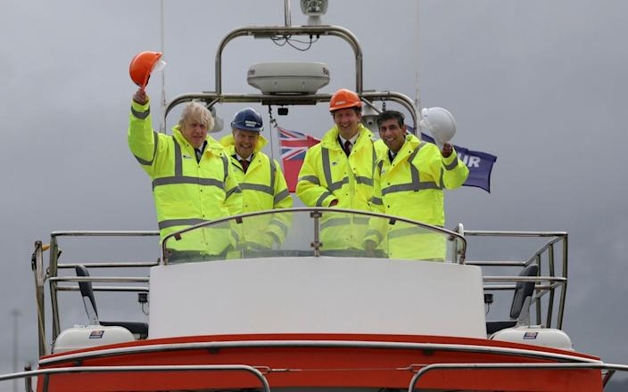 Boris Johnson and Rishi Sunak aboard a boat on the River Tees today - AP Pool