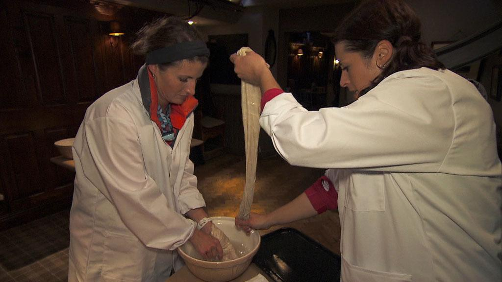 """Working Our Barrels Off"" -- In Detour A, Roller Derby moms Mona (left) and Beth (right) must prepare and eat Scotland\'s national dish, Haggis, in order to receive the next clue, on ""The Amazing Race."""