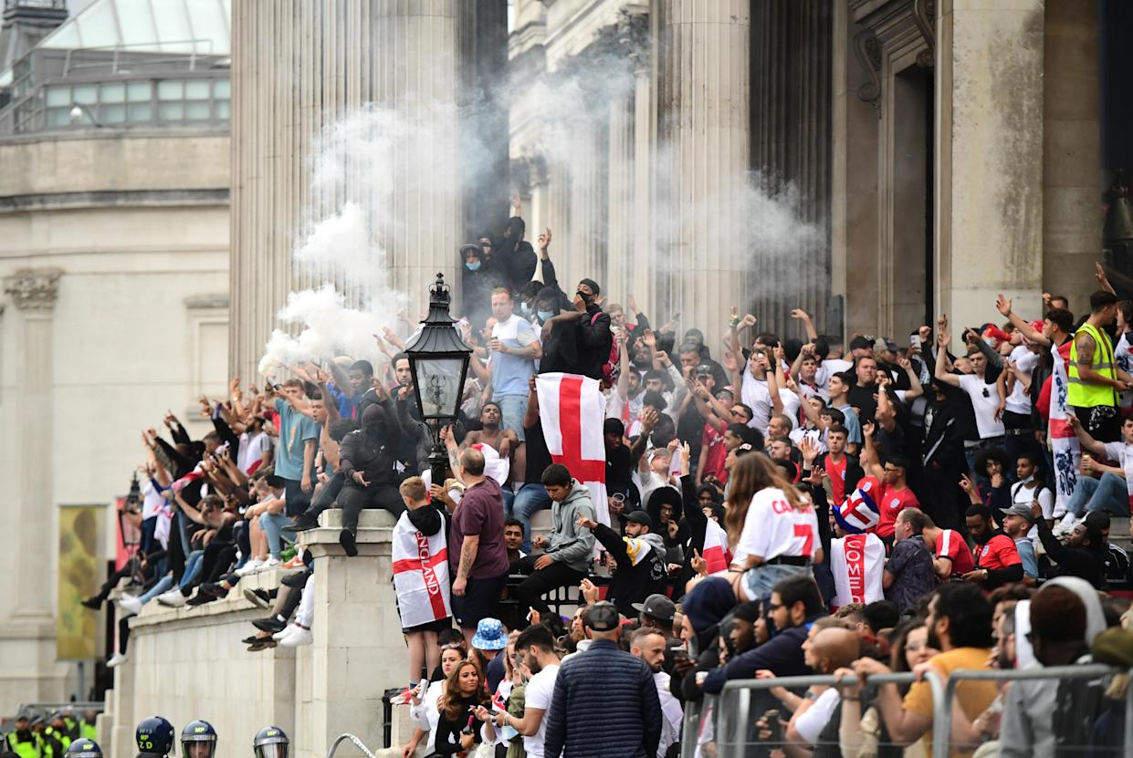 Fans on the steps of the National Gallery at Trafalgar Square, London before the UEFA Euro 2020 Final between Italy and England. Picture date: Sunday July 11, 2021.