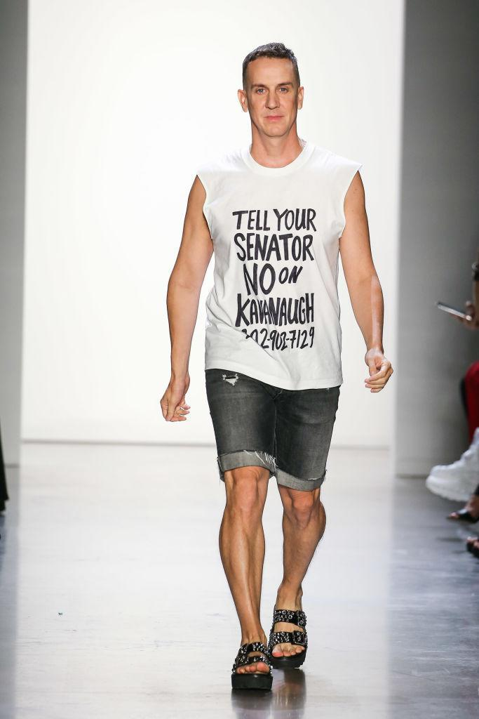 """<p>At the end of his show, Jeremy Scott walked the runway wearing a T-shirt that read, """"Tell Your Senator No on Kavanaugh 202-902-7129."""" The phone number refers you to the office of one of your senators so that you can express your opinion on the confirmation of Brett Kavanaugh, the president's <a href=""""https://www.usatoday.com/story/news/politics/2018/09/03/brett-kavanaugh-controversial-supreme-court-nominee-five-reasons/1143100002/"""" rel=""""nofollow noopener"""" target=""""_blank"""" data-ylk=""""slk:controversial"""" class=""""link rapid-noclick-resp"""">controversial</a> nominee for Supreme Court justice. (Photo: Getty) </p>"""
