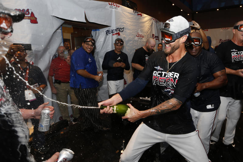 Atlanta Braves relief pitcher Shane Greene celebrates in the clubhouse after defeating the San Francisco Giants in a baseball game to clinch the NL East baseball title Friday, Sept. 20, 2019, in Atlanta. (AP Photo/John Bazemore)
