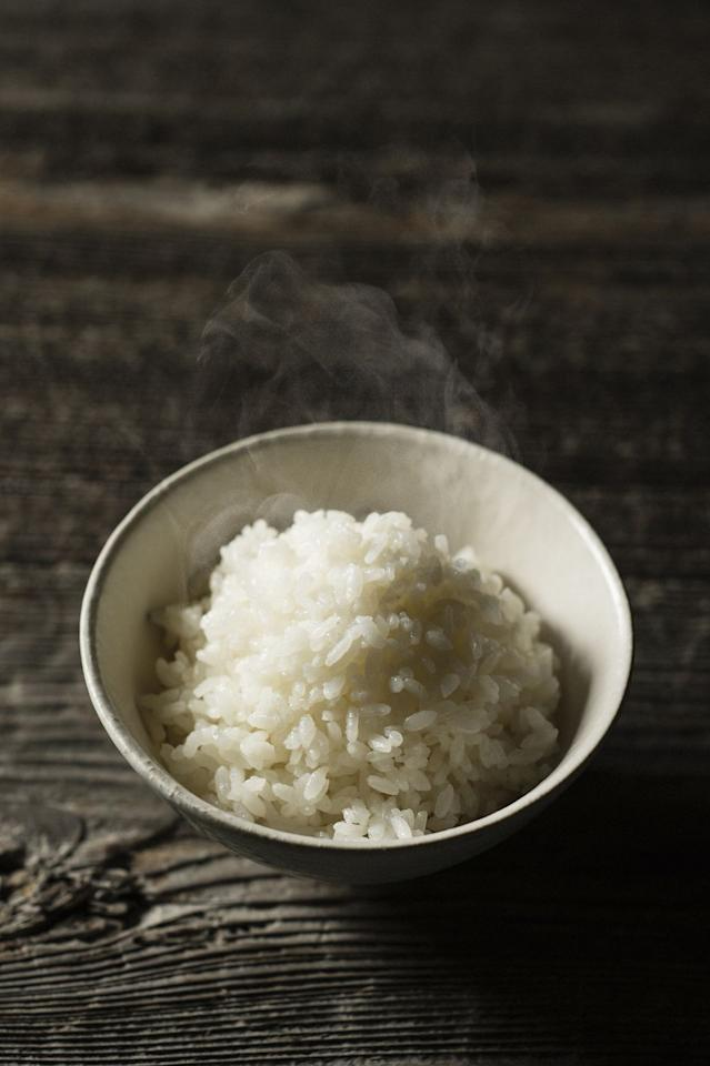 """<p>Yes.</p><p><a href=""""https://www.goodhousekeeping.com/institute/"""" target=""""_blank"""">Good Housekeeping Institute's</a> Cookery School Head Tutor Cher Loh says, """"Rice is tricky, not because of the reheating but because of how the cooked rice has been stored. If cooked rice is left out at room temperature for a few hours, toxins build up because of the spores in rice (bacillus cereus). These can survive cooking. So cooked rice should always be stored in the fridge. """"</p><p><a href=""""https://www.medicalnewstoday.com/articles/322775#:~:text=For%20each%20cup%20of%20rice,165%C2%B0F%20or%20higher."""" target=""""_blank"""">The two best ways to reheat rice</a> is to either stir-fry it in a hot frying pan until it is hot all the way through. Or by microwaving it with a couple of tablespoons of water for 3 - 4 minutes. Make sure it is piping hot before you eat it.</p><p>Only reheat <a href=""""https://www.delish.com/uk/cooking/a29571636/how-to-cook-basmati-rice/"""" target=""""_blank"""">rice</a> once. And never reheat fried rice, because it is essentially rice that has already been cooked twice.</p>"""