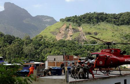 A man on a stretcher is carried to a helicopter after a building collapsed in Muzema community, Rio de Janeiro, Brazil April 12, 2019. REUTERS/Ricardo Moraes