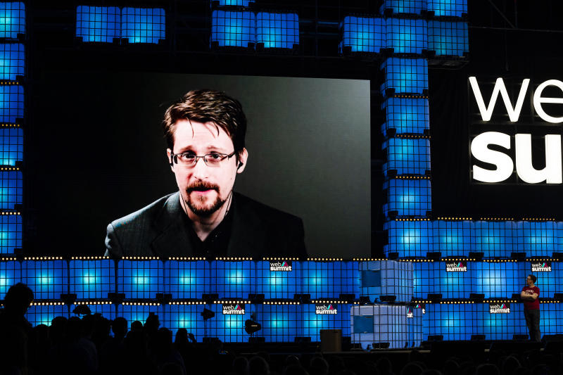 Edward Snowden and James Ball deliver a speech during the annual Web Summit technology conference in Lisbon, Portugal on November 4, 2019. (Photo by Rita Franca/NurPhoto via Getty Images)