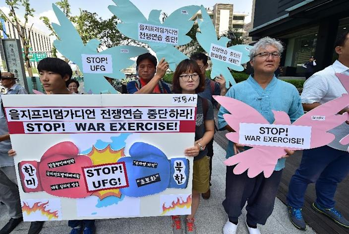 South Korean anti-war activists during a rally denouncing the annual Ulchi Freedom joint US-South Korea military exercise, near the US embassy in Seoul on August 17, 2015 (AFP Photo/Jung Yeon-Je)