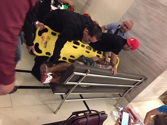 <p>First responders assist a victim of the Resorts World Manila attack in Manila, Philippines on June 1, 2016. (Tikos Low via Facebook) </p>