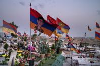 Armenian national flags wave on the wind at the military cemetery with the graves of the fallen soldiers during the during the fighting over Nagorno-Karabakh in 2020 year, outside Yerevan, Armenia. June 16. 2021. Nagorno-Karabakh lies within Azerbaijan but was under the control of ethnic Armenian forces backed by the government in Yerevan since a separatist war ended in 1994, leaving the region and substantial surrounding territory in Armenian hands. Hostilities flared in late September 2020, and the Azerbaijani military pushed deep into Nagorno-Karabakh and nearby areas in six weeks of fighting involving heavy artillery and drones that killed more than 6,000 people. (AP Photo/Areg Balayan)