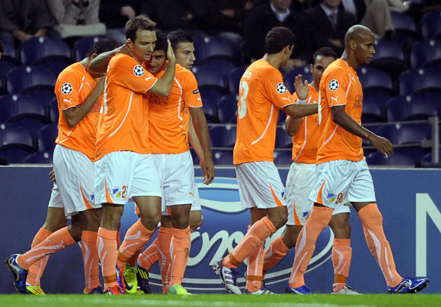Brazilian forward Ailton (3rdL) celebrates with teammates after scoring a goal during their UEFA Champions League Group G football match against FC Porto at the Dragao Stadium in Porto, on October 19, 2011. The match finished with a 1-1 draw. AFP PHOTO / MIGUEL RIOPA (Photo credit should read MIGUEL RIOPA/AFP/Getty Images)