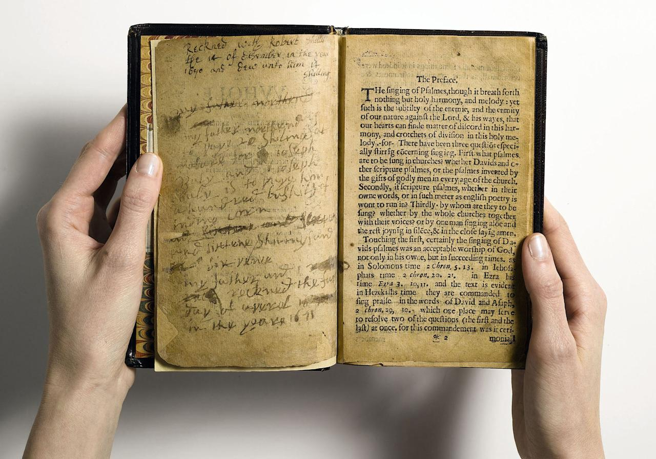 """FILE - This April 2013 file photo provided by Sotheby's and taken in New York shows what the auction house describes as """"the world's most valuable book,"""" the Bay Psalm Book, which is the first book ever printed in what is now the United States. Sotheby's, offering it Tuesday evening, Nov. 26, 2013 with a presale estimate of $15 million to $30 million, says it could set an auction record for any printed book. The book was published in Cambridge, Mass., by the Puritan leaders of the Massachusetts Bay Colony. It came just 20 years after the Pilgrims landed at Plymouth Rock. (AP Photo/Sotheby's, File)"""