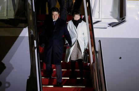 FILE PHOTO: Japanese PM Shinzo Abe and his wife Akie Abe arrive ahead of his meeting with U.S. President Donald Trump, at Joint Base Andrews, Maryland