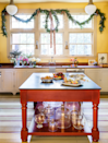 "<p>In the kitchen of her Colonial Revival-style home, Los Angeles-based designer <a href=""http://suzannerheinstein.com/"" rel=""nofollow noopener"" target=""_blank"" data-ylk=""slk:Suzanne Rheinstein"" class=""link rapid-noclick-resp"">Suzanne Rheinstein</a> dressed the sunny walls with swags of boxwoods for an intimate holiday party. Sconces by <a href=""https://annmorrislighting.com/"" rel=""nofollow noopener"" target=""_blank"" data-ylk=""slk:Ann-Morris"" class=""link rapid-noclick-resp"">Ann-Morris</a> shine on crystal from <a href=""https://us.williamyeowardcrystal.com/"" rel=""nofollow noopener"" target=""_blank"" data-ylk=""slk:William Yeoward"" class=""link rapid-noclick-resp"">William Yeoward</a>. The sink fixtures are from <a href=""https://www.waterworks.com/"" rel=""nofollow noopener"" target=""_blank"" data-ylk=""slk:Waterworks"" class=""link rapid-noclick-resp"">Waterworks</a>. The wall paint color is in Sweet Vibrations by Benjamin Moore.</p><p><a class=""link rapid-noclick-resp"" href=""https://www.benjaminmoore.com/en-us/color-overview/find-your-color/color/391/sweet-vibrations?color=391"" rel=""nofollow noopener"" target=""_blank"" data-ylk=""slk:Get the Look"">Get the Look</a></p>"